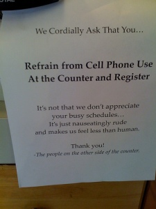 rude cell phone sign